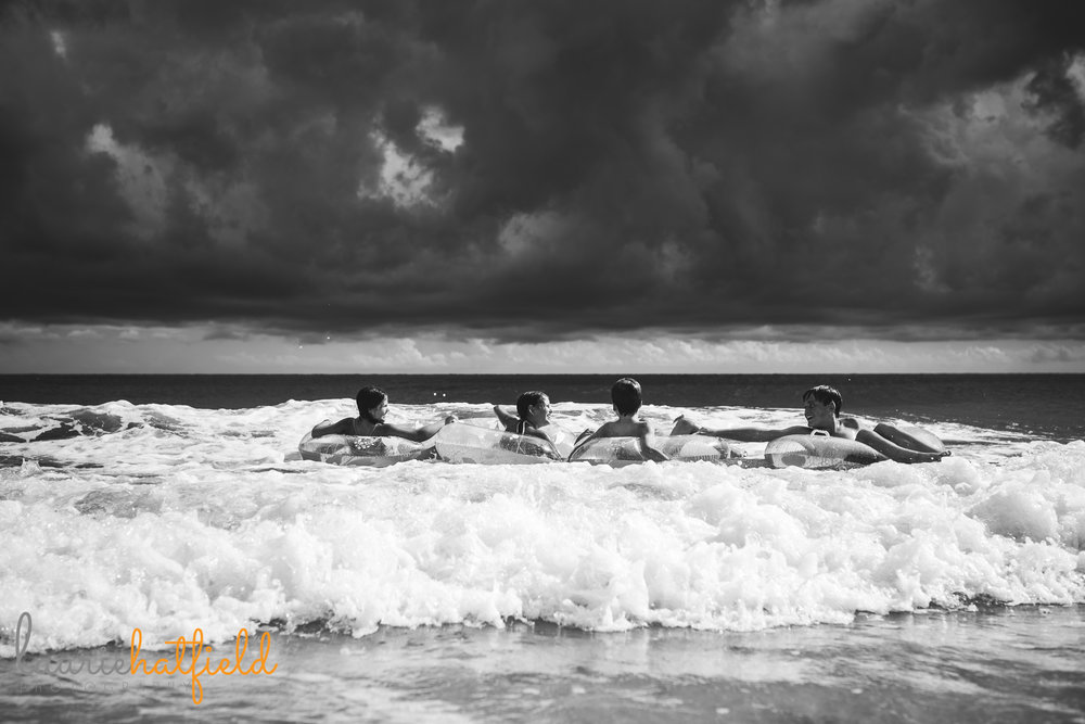 4 children playing in ocean | Mobile AL family photographer