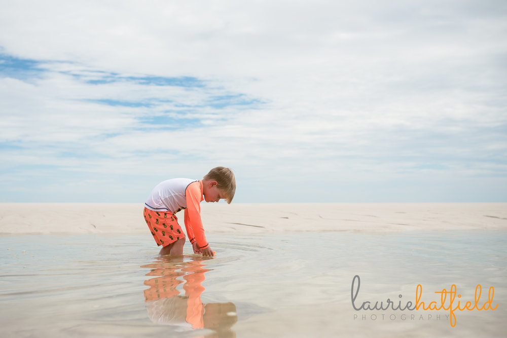 little boy playing on the beach | Mobile AL family photographer