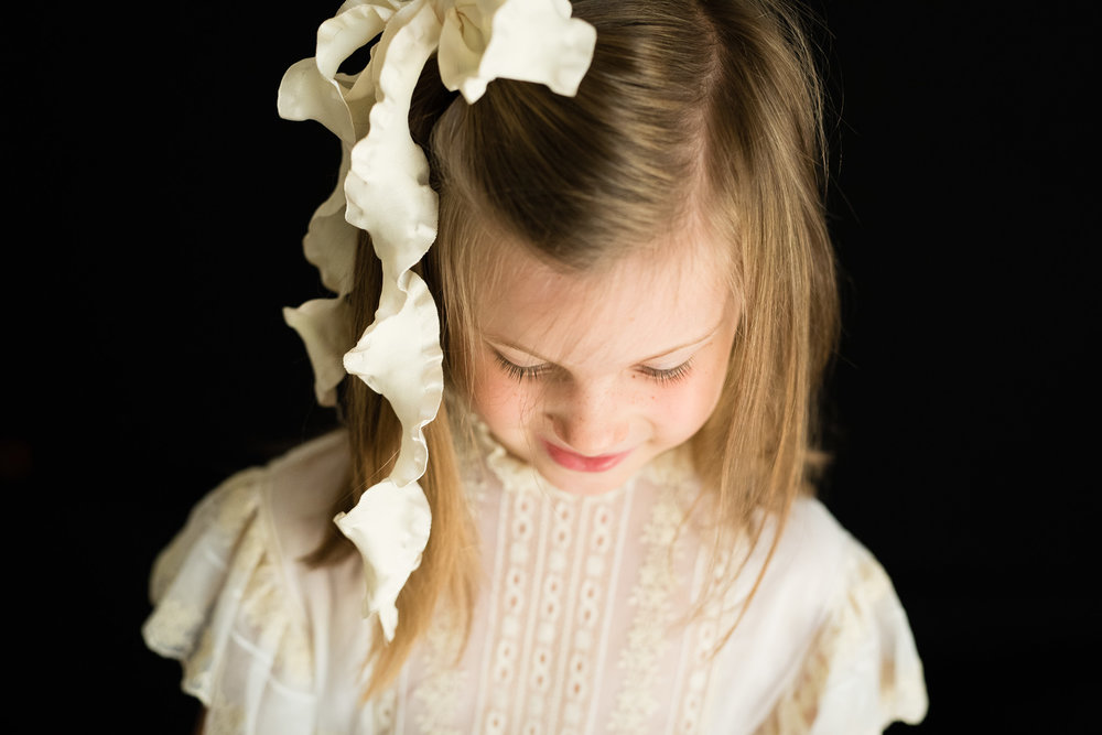 5-year-old girl with ribbon in her hair | Mobile AL school photography