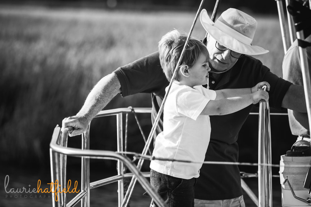 grandfather and grandson on sailboat | Mobile AL family photographer