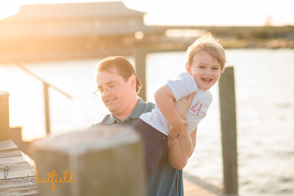 dad and son playing on pier | Mobile AL family photographer