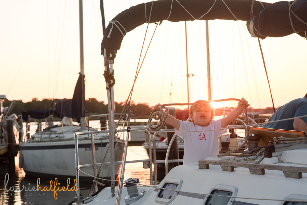 3-year-old boy on sailboat | Mobile AL family photographer