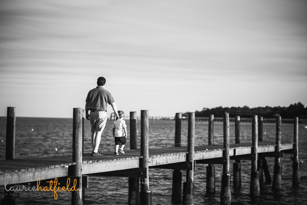 dad and son walking on pier | Mobile AL family photographer