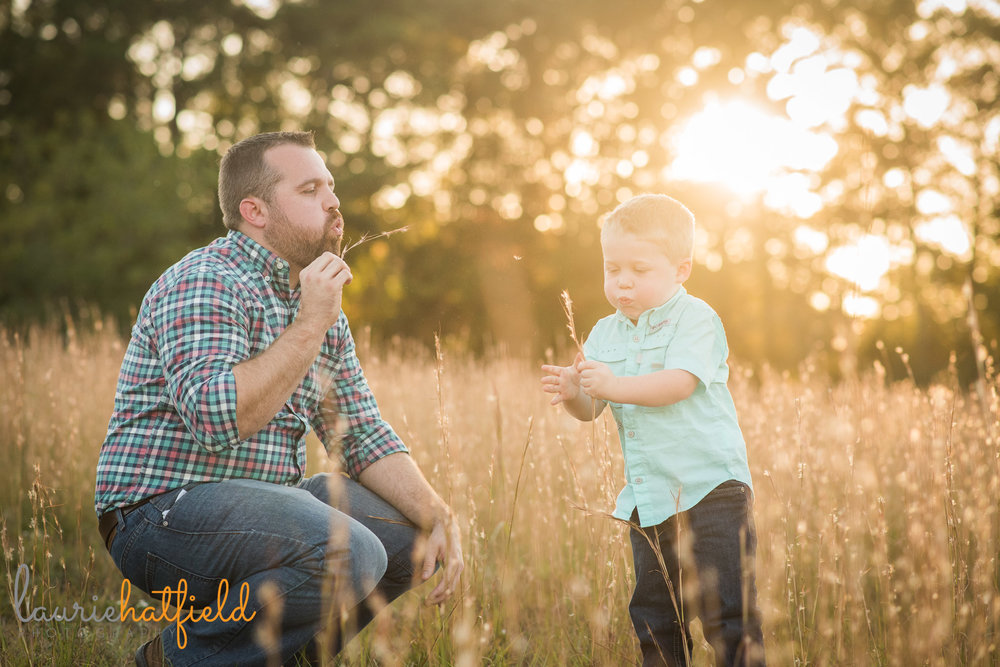 dad blowing dandelions with 3-year-old son | Mobile AL family photographer