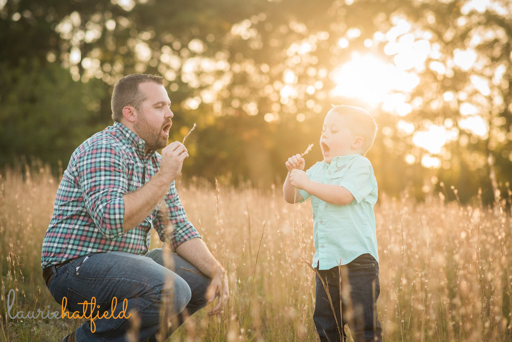 dad and son blowing dandelions in a field | Mobile AL lifestyle photographer