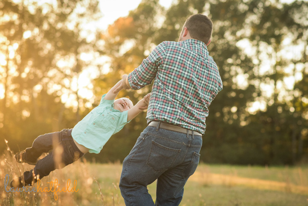 dad spinning little boy | Mobile AL family lifestyle photographer