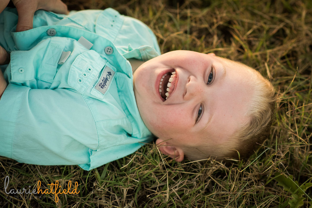 3-year-old boy laughing in grass | Mobile AL lifestyle family photographer
