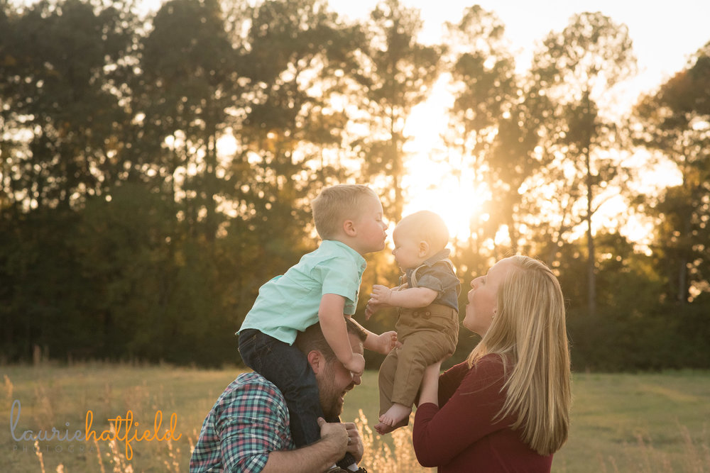 brothers on parents' shoulders | Saraland AL family photographer