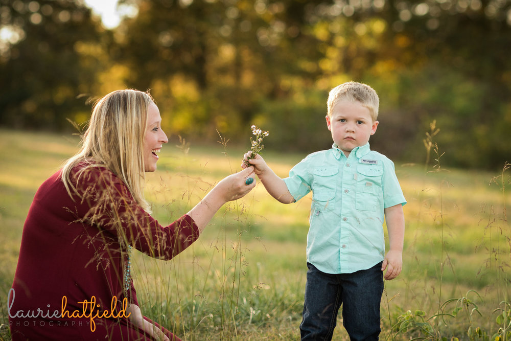 mom and little boy in field | Mobile AL family lifestyle photographer