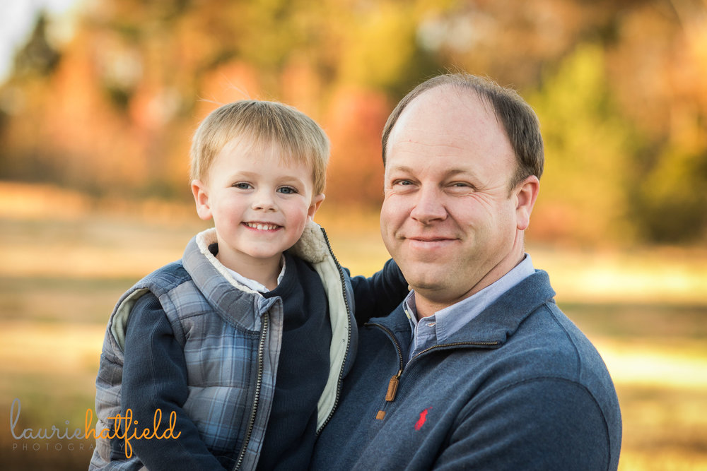 dad and 3-year-old son smiling at camera | Mobile AL family photographer