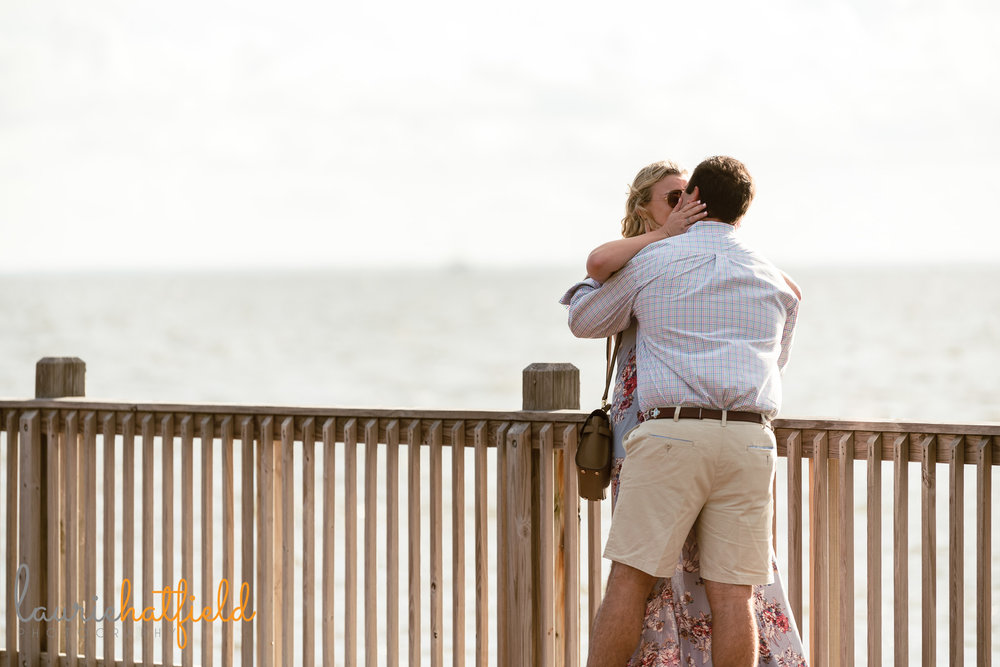 couple kissing after engagement | Mobile AL proposal photographer