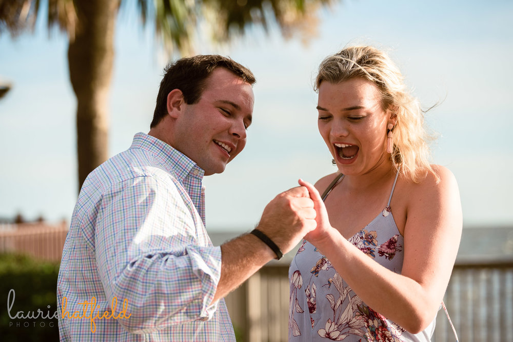 couple looking at ring after engagement | Mobile AL proposal photographer