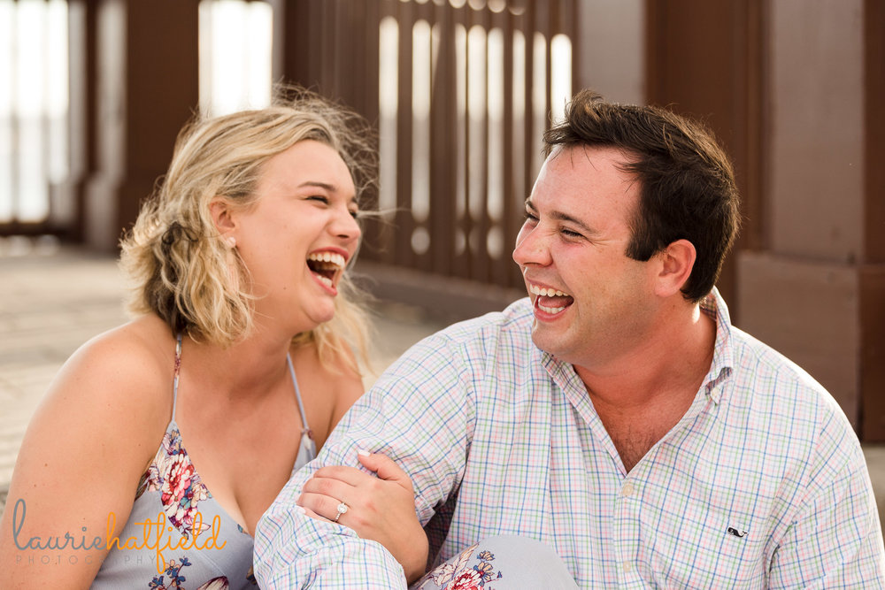 couple laughing together during engagement photo session | Mobile AL proposal photographer