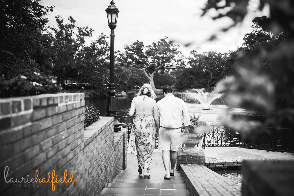 couple walking after getting engaged | Mobile AL proposal photographer