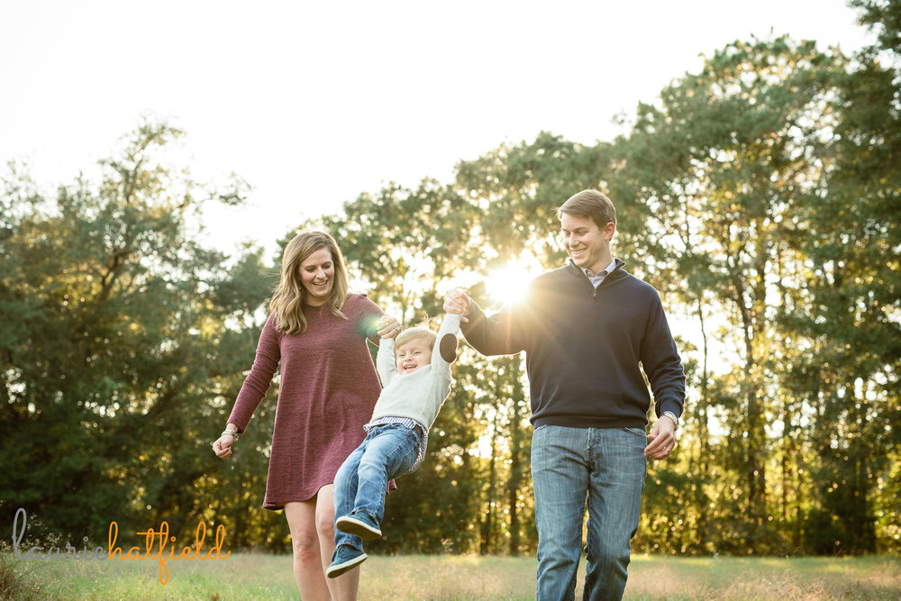 family of 3 playing in field | Mobile AL lifestyle photographer