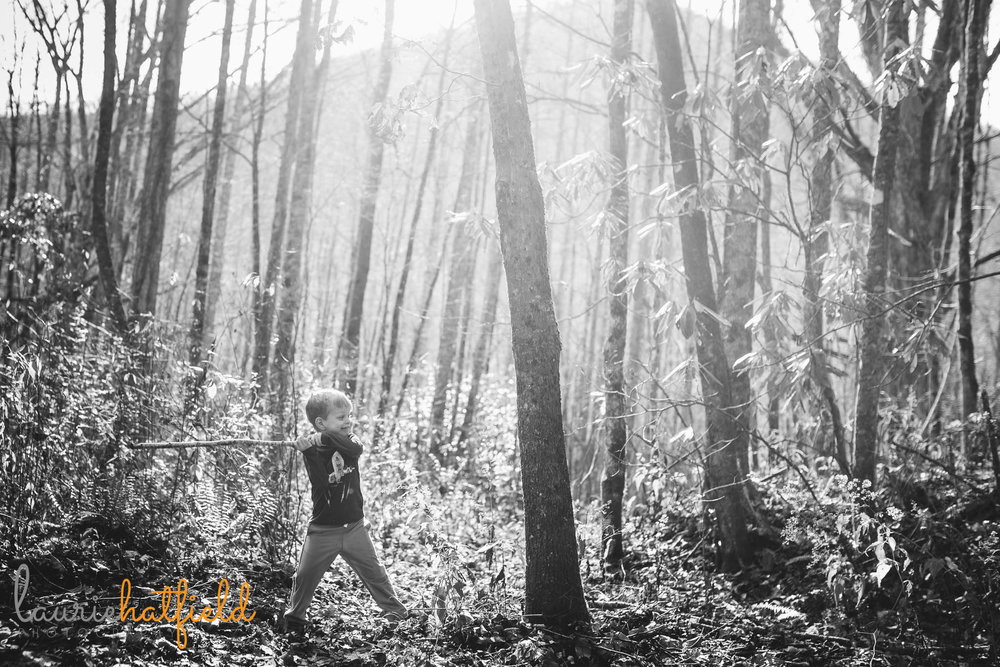 boy playing with stick in the woods | Mobile AL child photographer