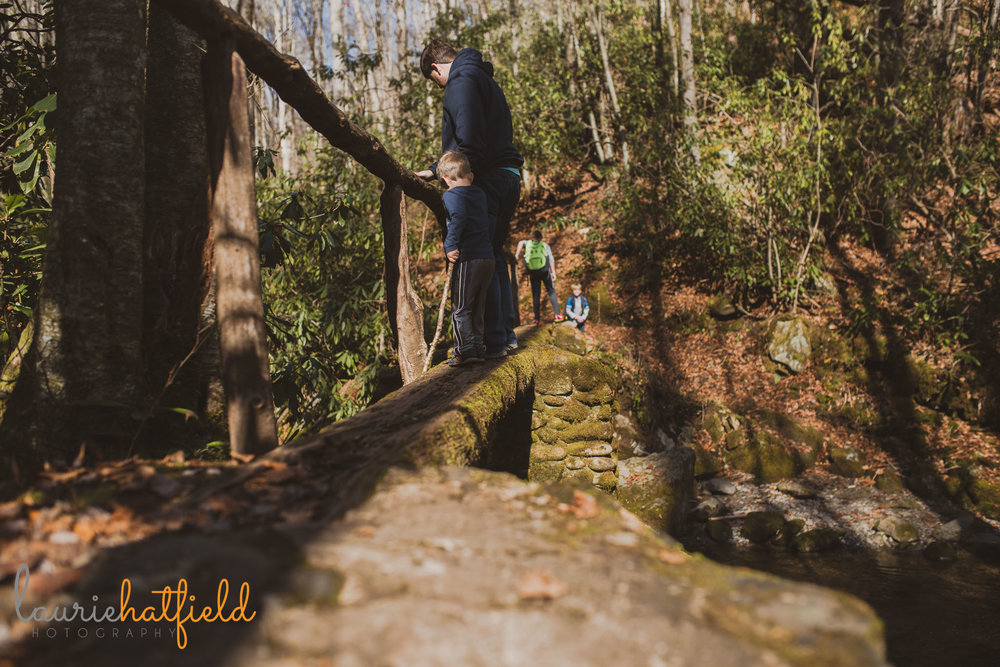 dad and son crossing bridge | Mobile AL family photographer