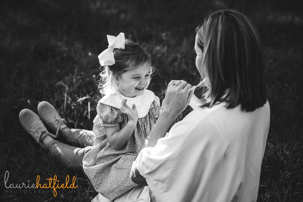 mom holding 3-year-old daughter in her lap | Mobile AL family photographer