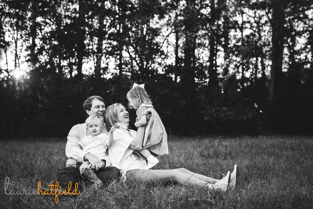 family of four in field | Pensacola FL lifestyle photographer