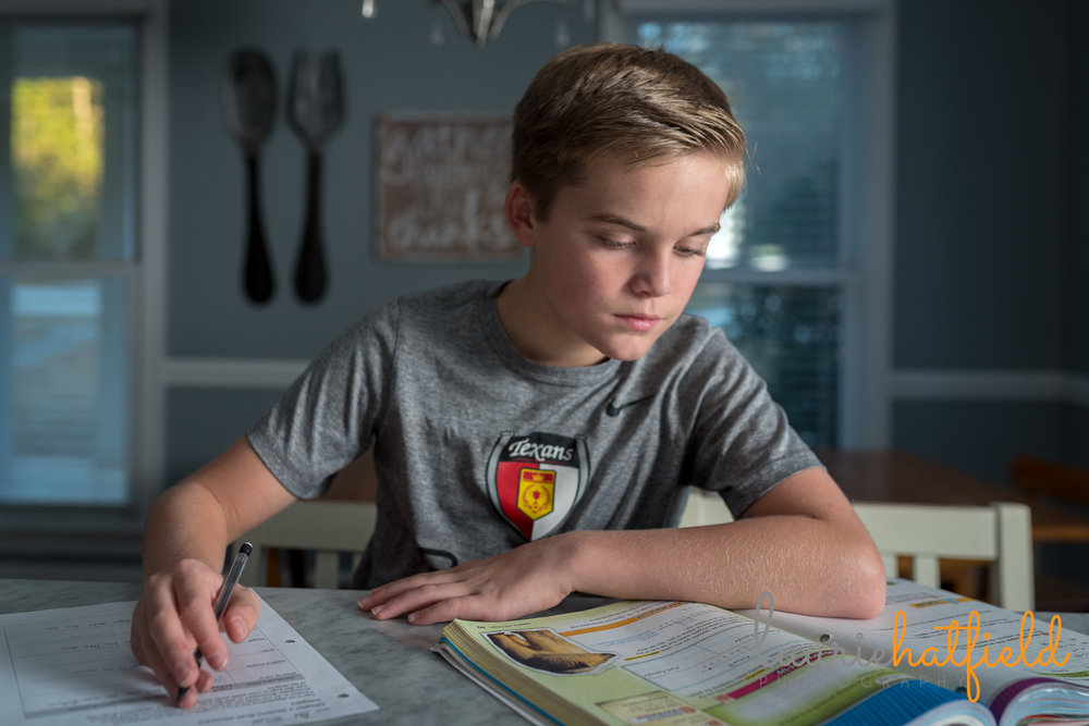 6th grade boy doing homework | Mobile AL family photographer