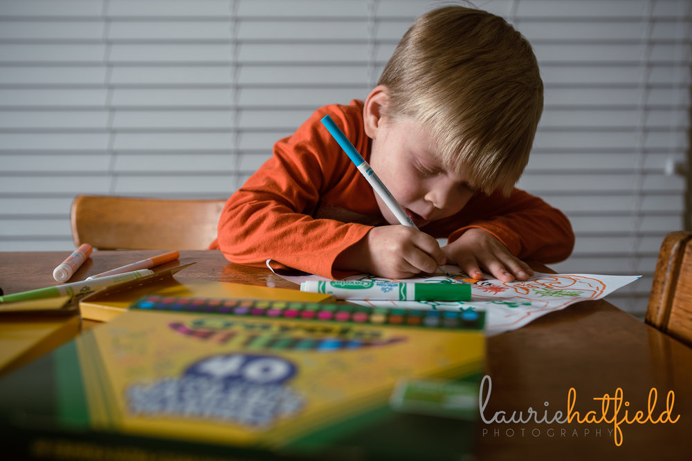 little boy coloring at table | Mobile AL family photographer