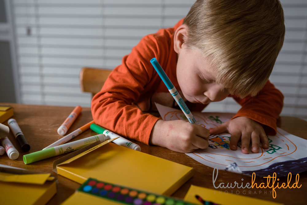 4-year-old boy and artwork | Saraland AL family photographer