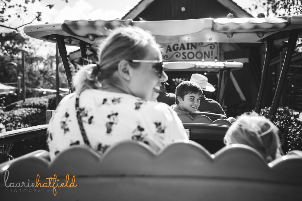 riding Goofy's barnstormer | Fairhope AL family photographer