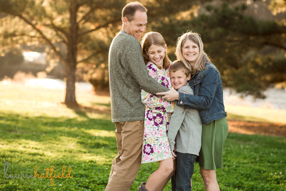 family of four hugging | Mobile AL lifestyle photographer