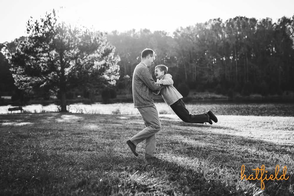 dad swinging son in air | Mobile AL family photographer