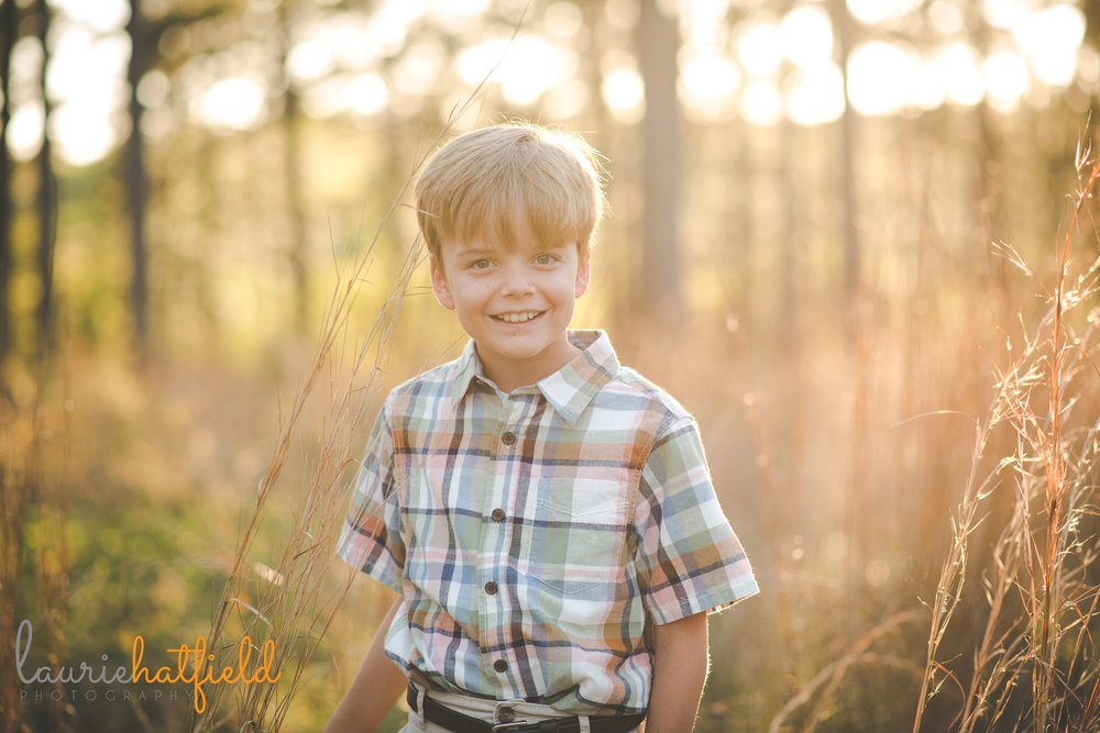 8-year-old boy portrait in field | Fairhope AL family photographer