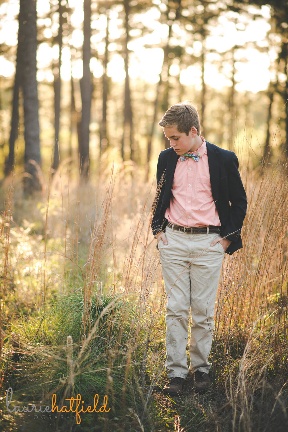 12-year-old boy walking in field | Daphne AL family photographer