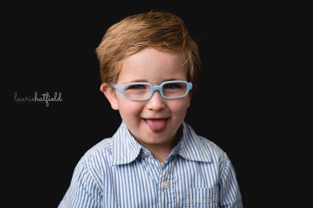 little boy with blue glasses | Fairhope AL school photography