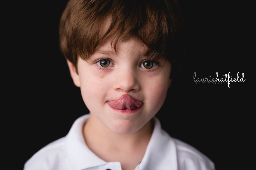 little boy with tongue sticking out | Mobile AL school photographer