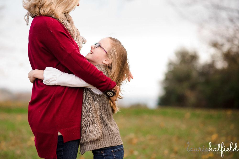 little girl hugging mom | Fairhope AL family photographer