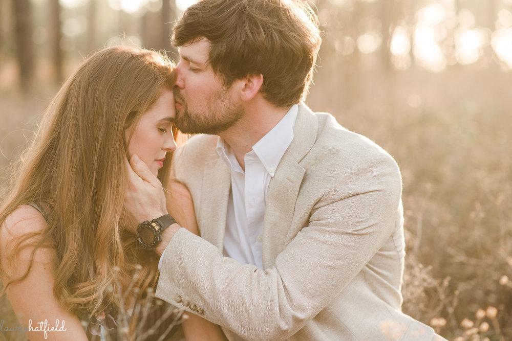 husband kissing wife | Mobile AL newborn photographer