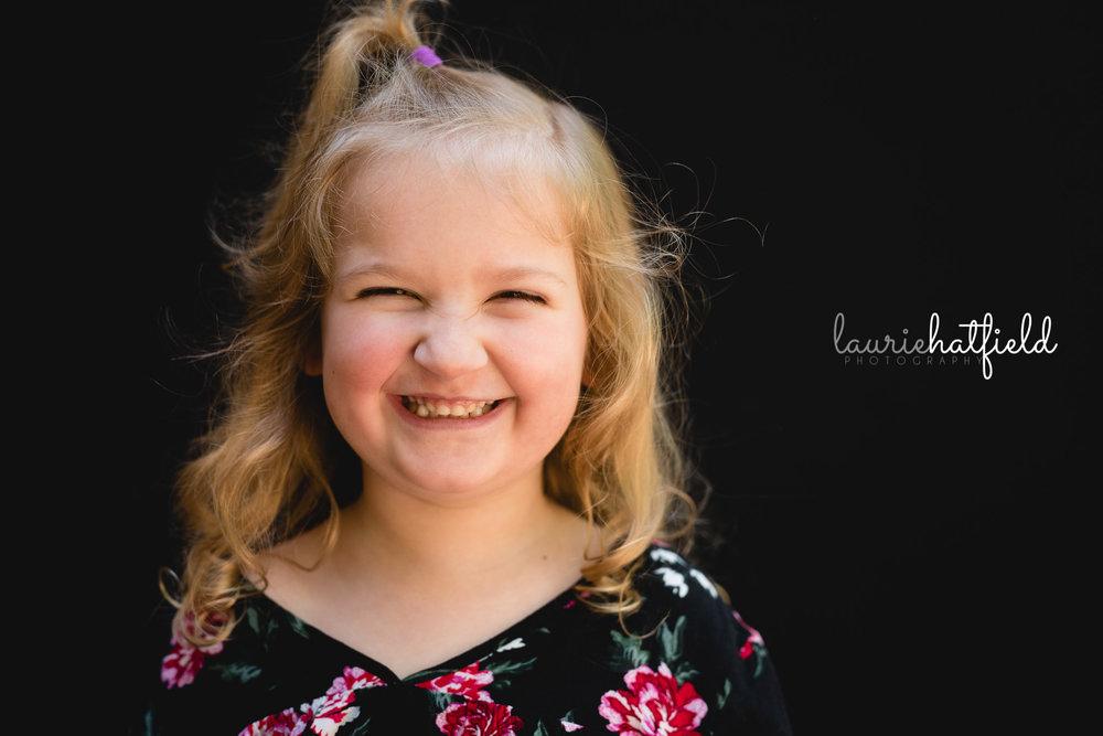 little girl with black floral dress | Mobile AL school portraits