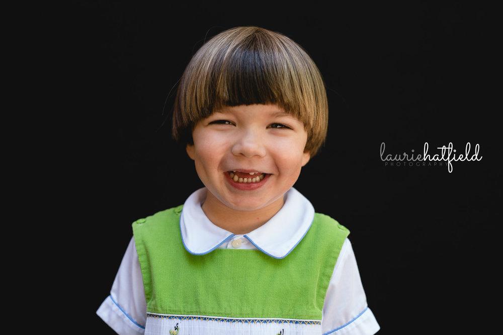 preschool boy in green jon jon | Mobile AL school portraits