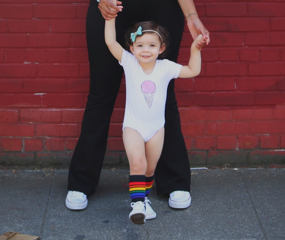 Mila's wearing our super soft and stretchy Ice Cream bodysuit.  Bow:  Penny and Mama    Socks:  Pride Socks