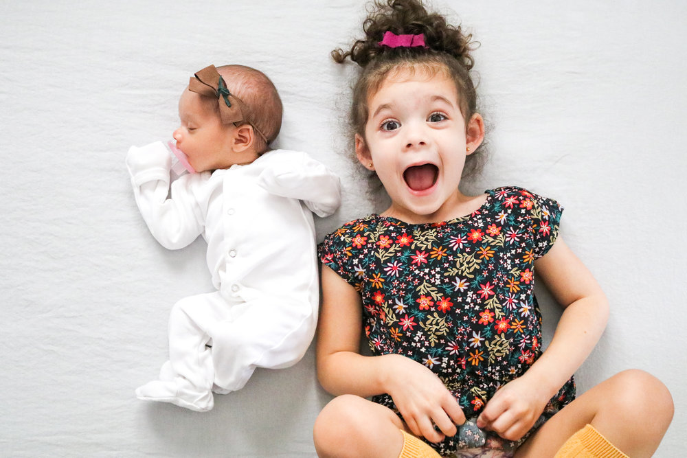 I can't get enough of these two! (Bow: Nova -   Hello Wild Baby Co   Mila -   Bee Frances   Onesie:   L'ovedbaby   Mila's Dress: Gap)