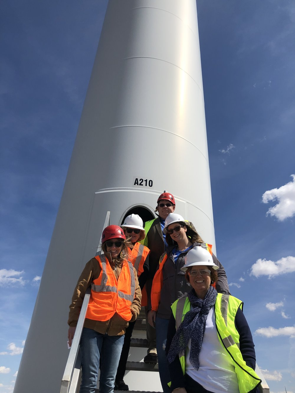 A perfect, windy day to see a turbine up-close at EDP Renewables Timber Roads II in Paulding County.  From the top:  Jerry Zielke, Paulding County Economic Development Inc. Director;  LuAnne Cook, Office of the Governor NW Regional Liaison;  Mikayla Pieper, Paulding Chamber of Commerce Executive Director;  Erin Bowser, EDP Renewables;  Susan Munroe, Chambers for Innovation and Clean Energy.