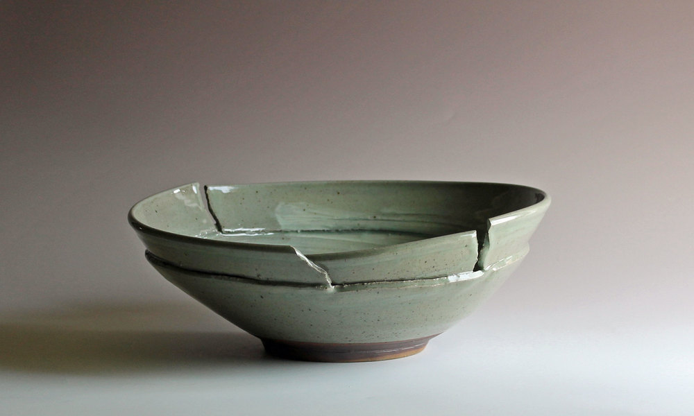 Bowl with torn & reattached rim
