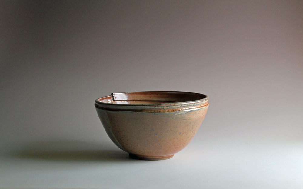 Bowl with altered rim & shino glaze