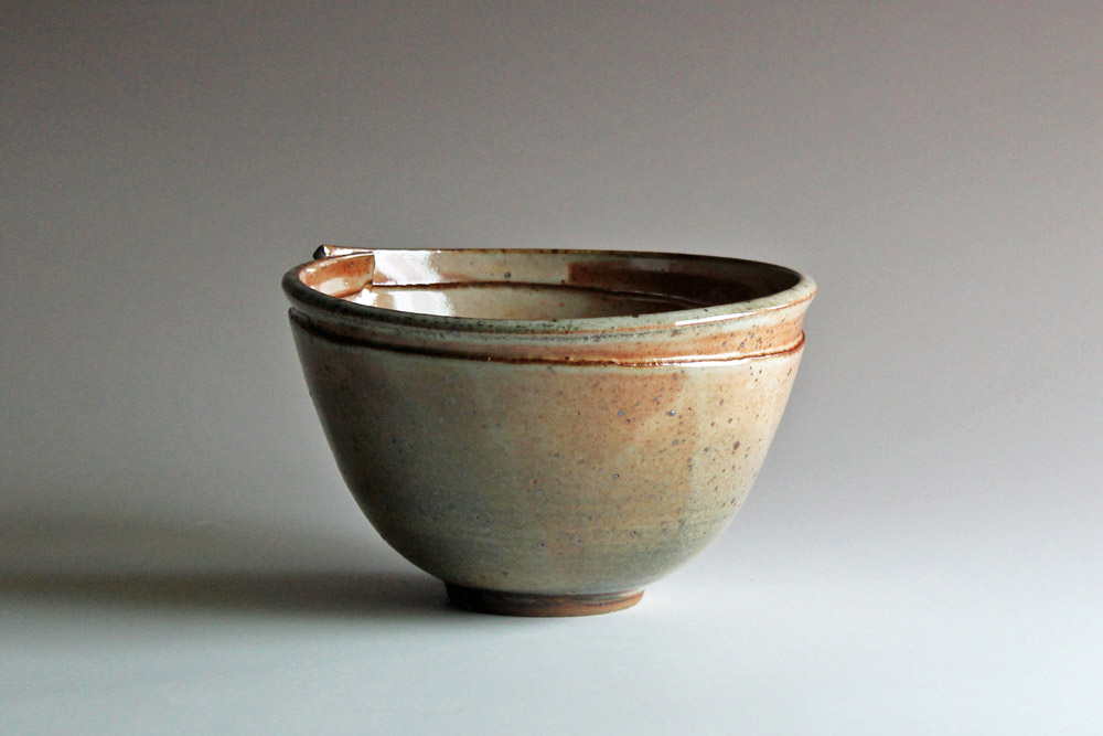 Bowl with broken rim & shino glaze
