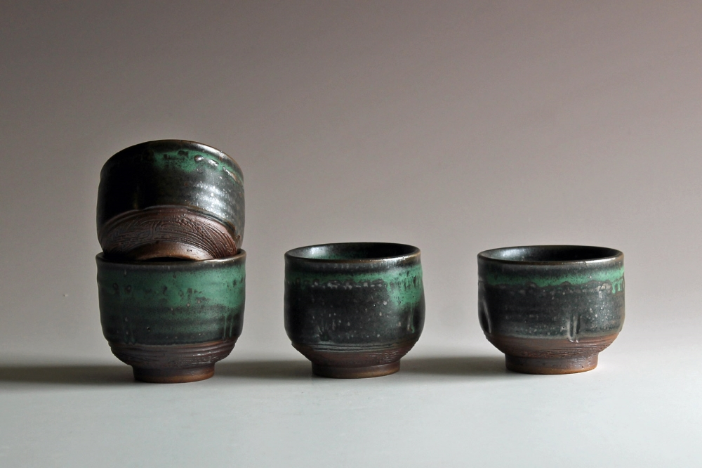 Little cups with matte green glaze