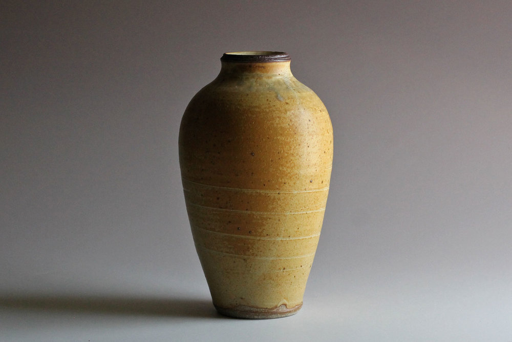 stoneware vase with yellow glaze