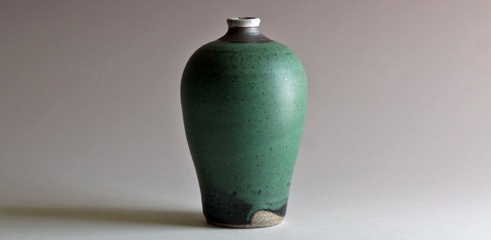 stoneware bottle with green glaze