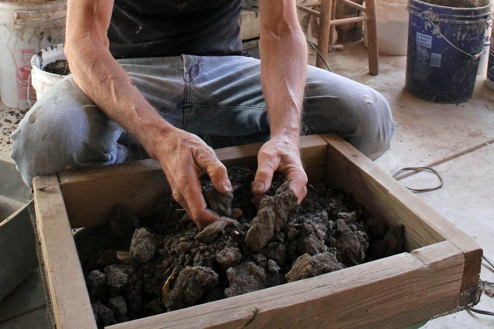 Sifting local stoneware clay
