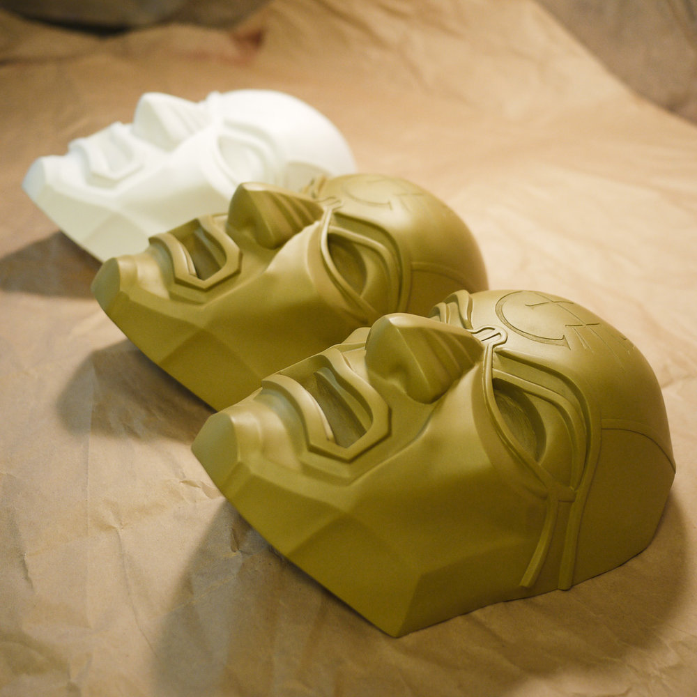 Dishonored Overseer masks out of the mold before polishing