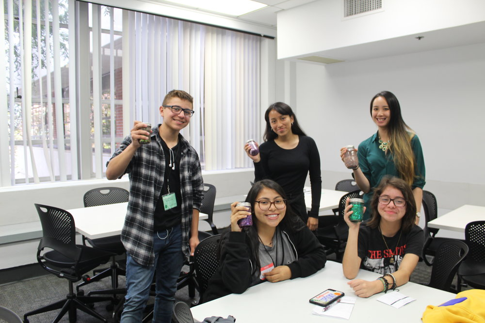 Splash participants and the instructor, Kat Chan, showcase the jars they made in the Mindfulness 101 class.