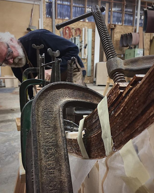 Dad bending the rocker for moms new curly Koa rocking chair. #robbyoungsfinewoodworking ROBBYOUNG.COM